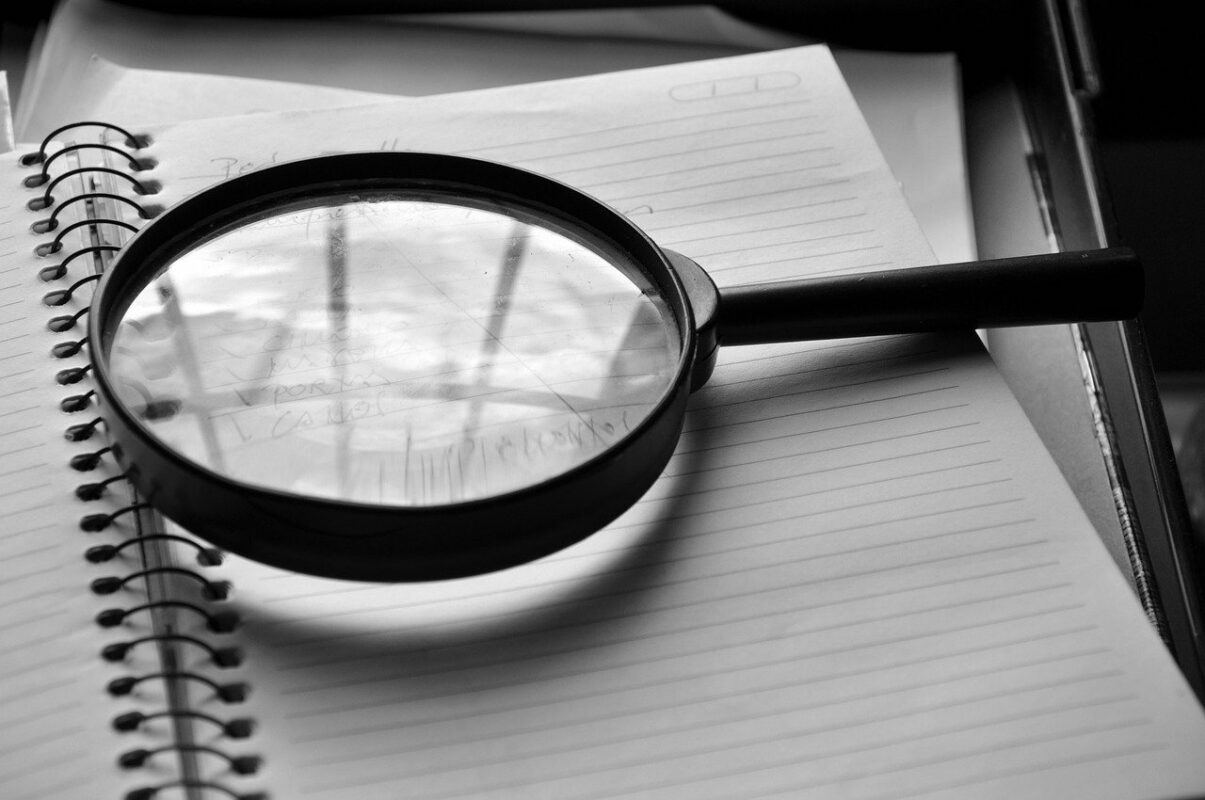 magnifying glass, notebook, detail