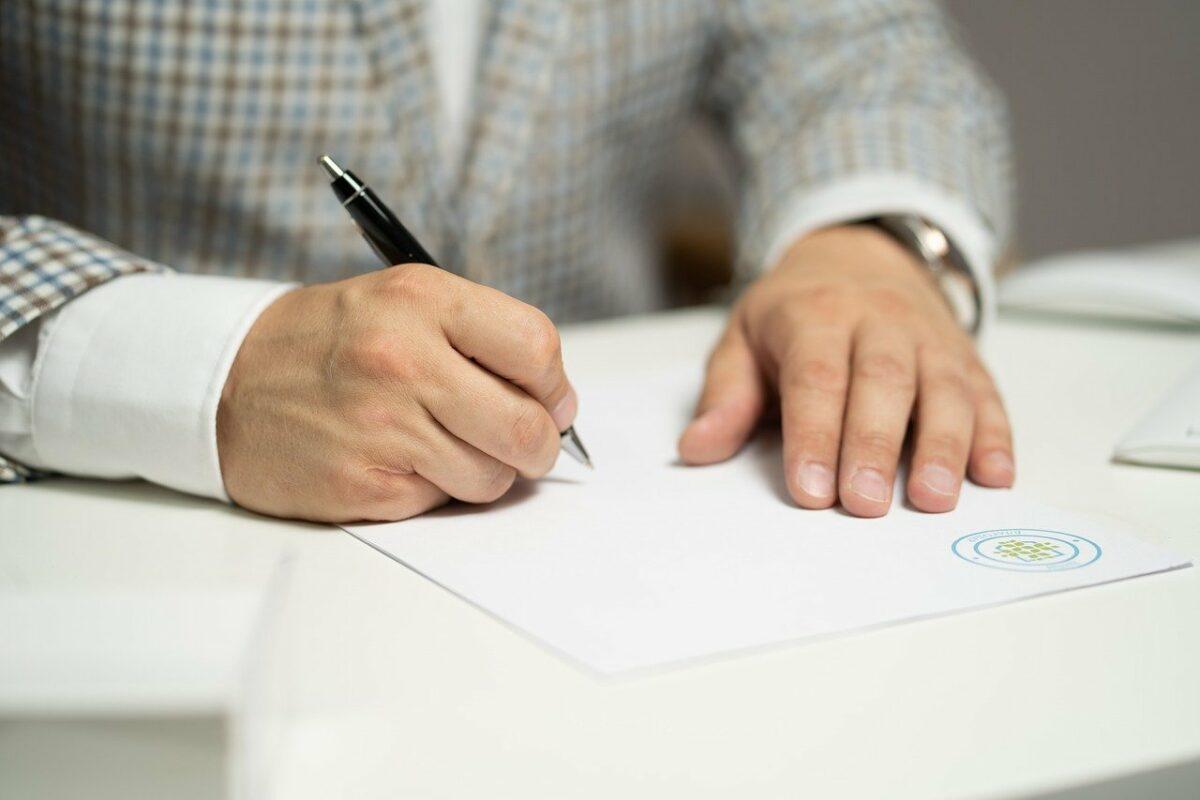 man, sign, paper